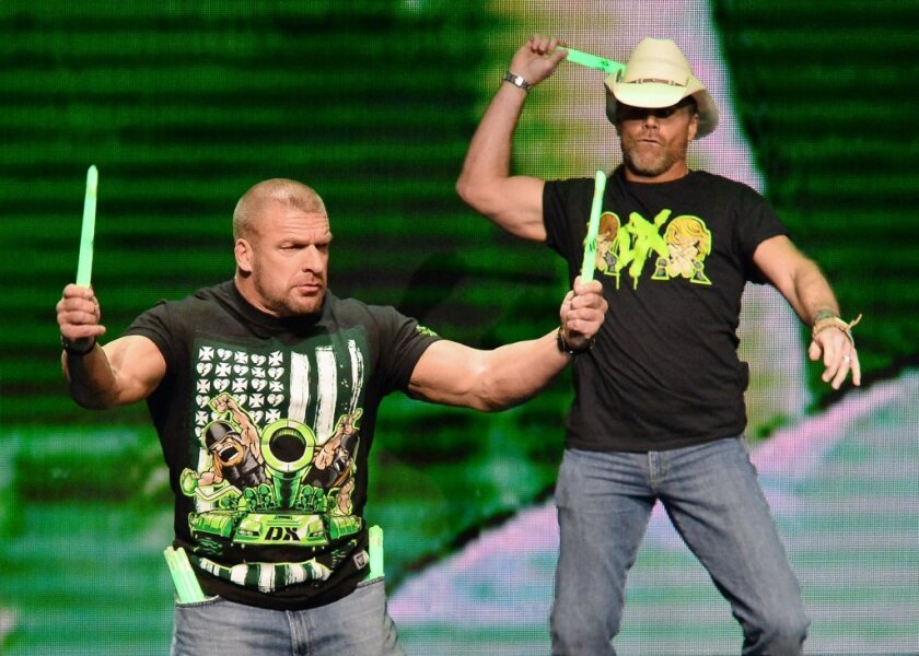 Triple H, left, and Shawn Michaels at the WWE's network announcement.