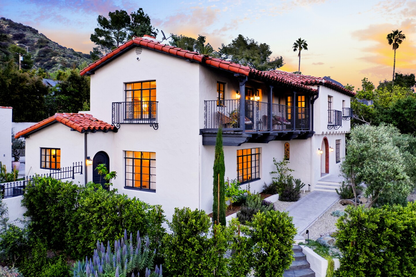 Listed for $2.685 million, the Spanish Revival-style home recently underwent a two-year renovation that introduced a host of modern updates while preserving certain period details. Features include redwood beams, arched doorways and a grand fireplace in the living room. Custom arched steel doors connect the indoor-outdoor living spaces. The 4,100-square-foot house has four bedrooms including two master suites. A La Cornue range with bronze accents steals the show in the kitchen.