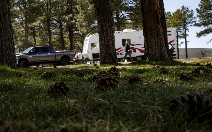 A family sets up their RV at Black Bart's RV Park in Flagstaff, Ariz., mid-pandemic.