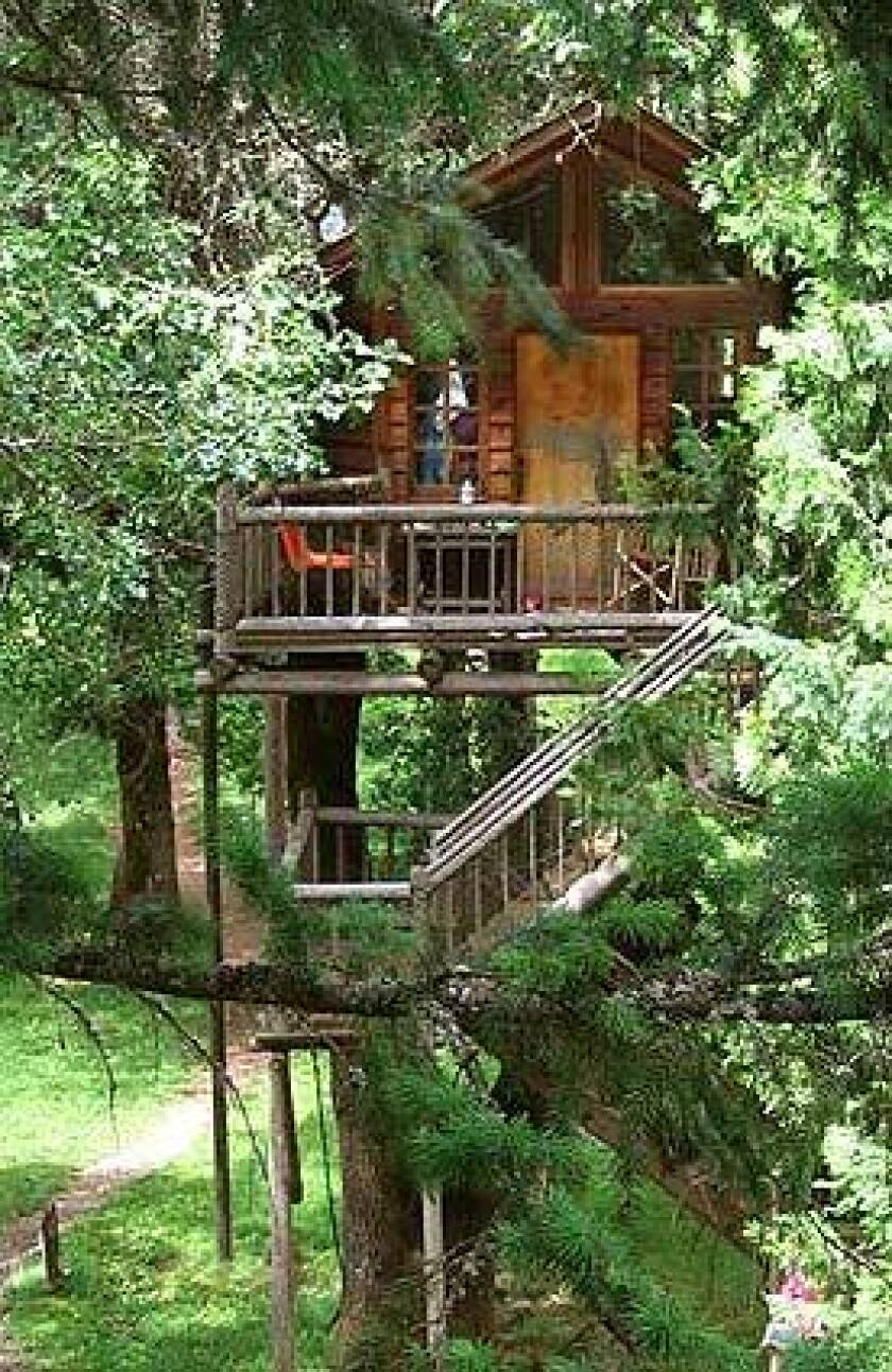 Peacock Perch is one of 11 treehouses guests can rent at Out 'n' About Treesort in Oregon's Siskiyou Mountains, about 20 miles from the California border. The resort's bathhouse pavilion is on the ground level.