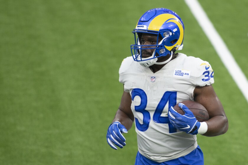Malcolm Brown carries the football during downtime when the Rams held their first scrimmage at SoFi Stadium.