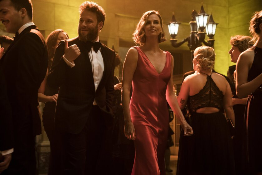 """(L-R) - Fred Flarsky (Seth Rogen) and Charlotte Field (Charlize Theron) in """"LONG SHOT."""" Credit: Murr"""