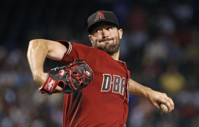 Arizona Diamondbacks' Robbie Ray throws a pitch against the Los Angeles Dodgers during the first inning of a baseball game Sunday, July 17, 2016, in Phoenix. (AP Photo/Ross D. Franklin)