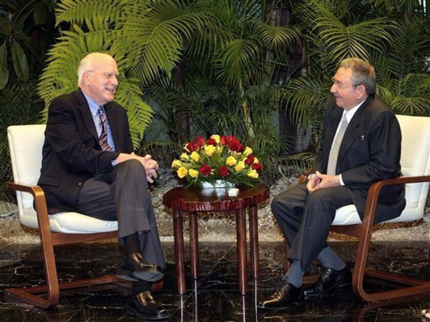 In this picture released by Cuba's state newspaper Granma, Cuba's President Raul Castro, right, talks with U.S. Sen. Patrick Leahy at Revolution Palace in Havana, Cuba, Tuesday, Feb. 19, 2012. U.S. lawmakers confirmed on Wednesday that they visited an American man whose detention and long sentence