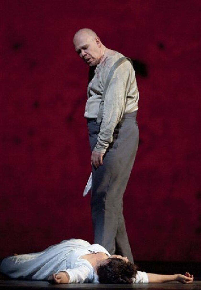 "In this photo released by the Metropolitan Opera, Alan Held in the title role stands over Waltraud Meier as Marie during a dress rehearsal of Berg's ""Wozzeck"" at the Metropolitan Opera in New York, Friday, April 1, 2011. (AP Photo/Metropolitan Opera, Cory Weaver) NO SALES"