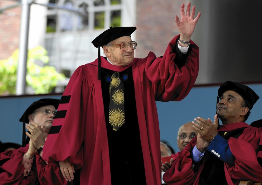 UC Santa Barbara physicist Walter Kohn, who shared the 1998 Nobel Prize in chemistry, waves to the audience during commencement exercises at Harvard in 2012.