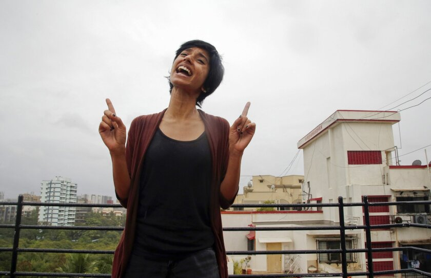 In this June 25, 2016 photo, Indian rapper Sofia Ashraf demonstrates her skills in Mumbai, India. The South Indian rapper is targeting Dow Chemical with rhymes - demanding the U.S. company pay more in victims' compensation and environmental damages stemming from a horrific chemical gas leak that killed thousands of people and sickened countless others.(AP Photo/ Rajanish Kakade)