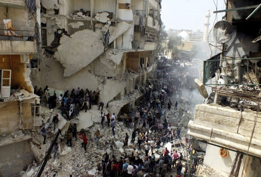 Civilians in Aleppo, Syria's largest city, search for survivors and bodies in the rubble of a building struck by an apparent airstrike.