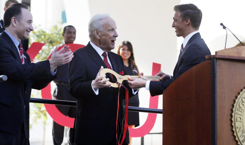 Conrad Prebys (middle) receives a key from Associated Students President Josh Morse (right) and SDSU President Elliot Hirshman (left) during a ceremony in February. Prebys donated $20 million to SDSU.