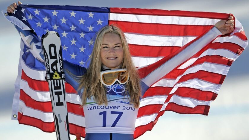 FILE -In this Feb. 20, 2010 file photo, bronze medalist Lindsey Vonn of the United States hold the S