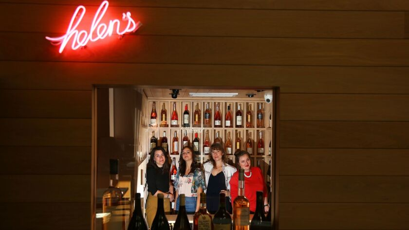 Helen Johannesen, third from left, in her wine shop, Helen's Wines, with Molly Kelley, Bethany Kocak