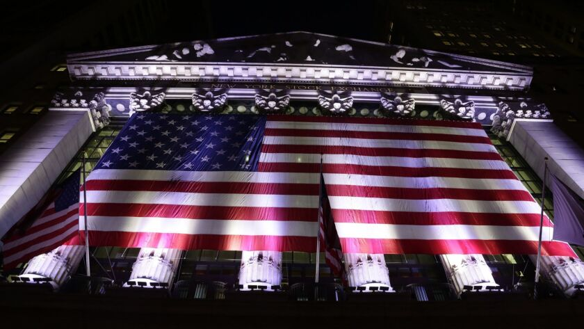 An American flag hangs on the front of the New York Stock Exchange in 2017.