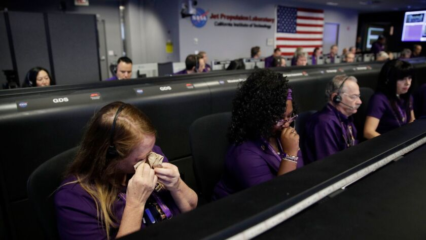Engineer Nancy Vandermay wipes away tears in the mission control at NASA's Jet Propulsion Laboratory after confirmation that the Cassini spacecraft had perished in Saturn's atmosphere on Sept. 15.