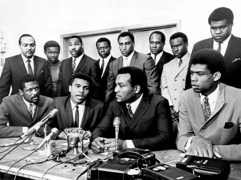 Kareem Abdul-Jabbar, front right, joins (right to left seated) Jim Brown, Muhammad Ali and Bill Russell on June 4, 1967.