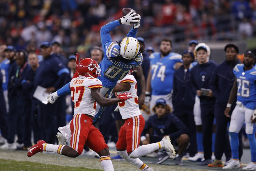 Chargers receiver Mike Williams catches a 50-yard pass from quarterback Philip Rivers late in the fourth quarter of a game against the Chiefs in Mexico City.