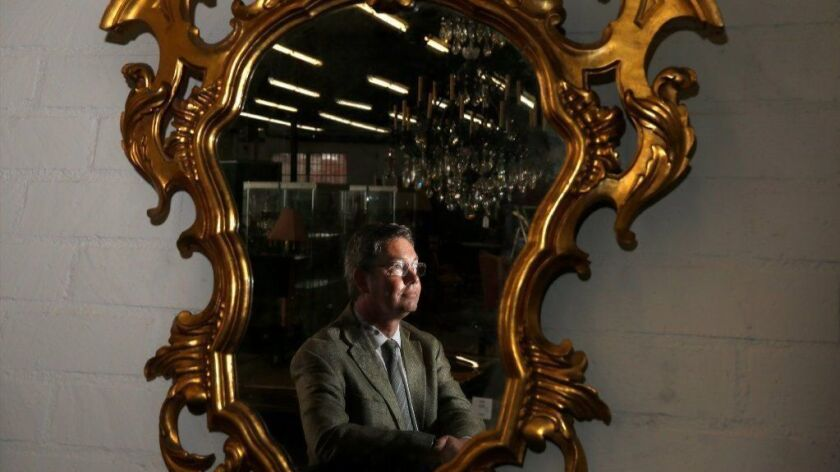 Andrew Jones, founder of Los Angeles' newest auction house, poses for a portrait at downtown L.A. offices of Andrew Jones Auctions.