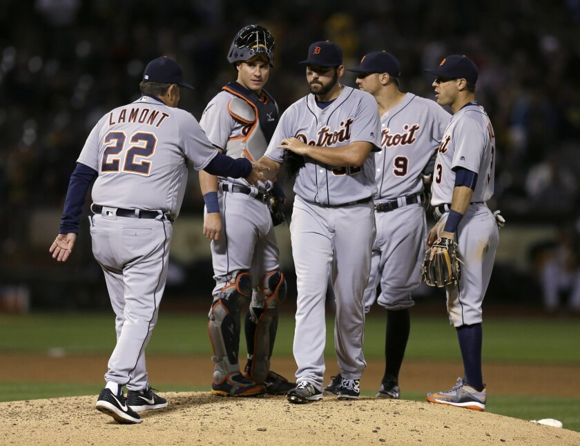 Detroit Tigers manager Gene Lamont, left, removes pitcher Michael Fulmer from the baseball game against the Oakland Athletics during the eighth inning Friday, May 27, 2016, in Oakland, Calif. (AP Photo/Ben Margot)