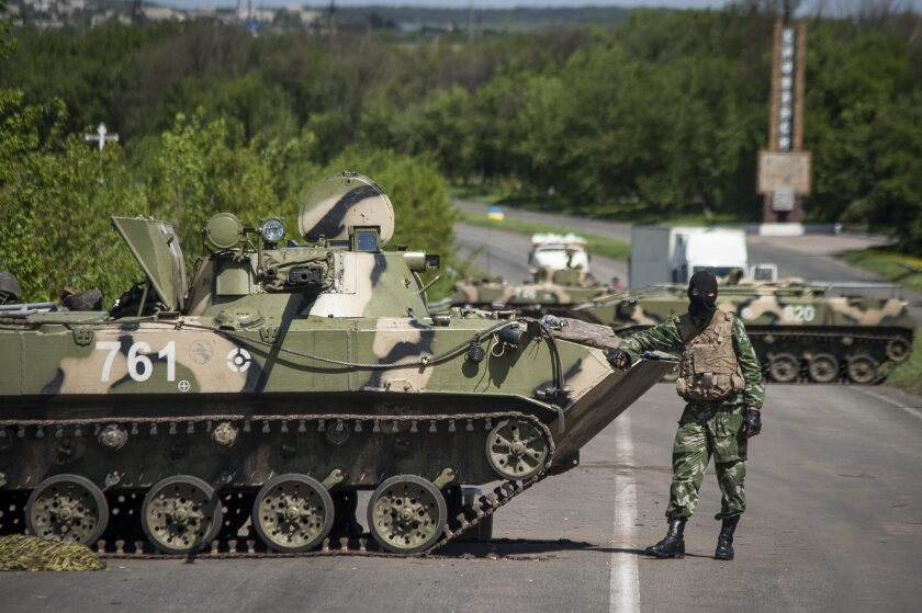 A Ukrainian soldier stands guard at a checkpoint near Slovyansk, the focal point of an escalating conflict between government forces and the pro-Russia separatists in eastern Ukraine.