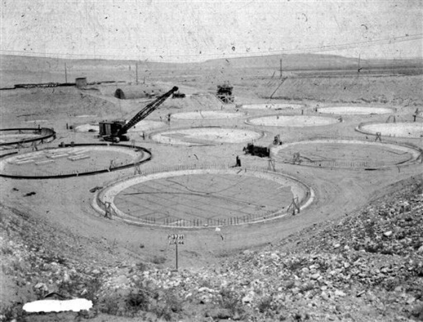 "FILE -- This photo provided by the U.S. Dept. of Energy,  shows the construction of a ""tank farm"" to store nuclear waste in 1944 on the Hanford nuclear reservation near Richland, Wash. It is one of collection of photos documenting life in and around the reservation from 1943-1967. Six underground r"