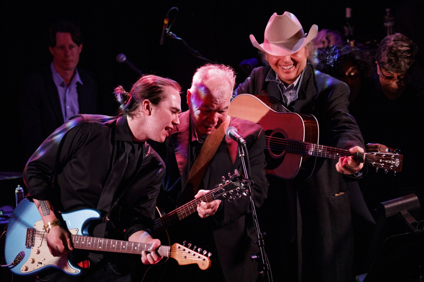 Veteran singer-songwriter John Prine, center, is flanked by his son, Jody, left, and roots country star Dwight Yoakam and soul singer Bettye LaVette during the finale of an all-star Americana tribute to his music Saturday at the Troubadour in West Hollywood.