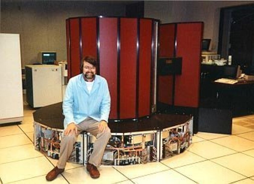 Smarr sits with a Cray supercomputer at the University of Illinois in the 1980s.