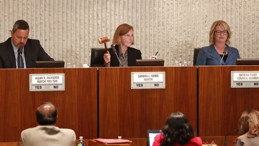 """Mayor Sandy Genis raises her gavel to call for order as opponents of Senate Bill 54 cheered during Tuesday's City Council meeting. The council voted 3-2 to adopt a resolution opposing the """"sanctuary state"""" law."""