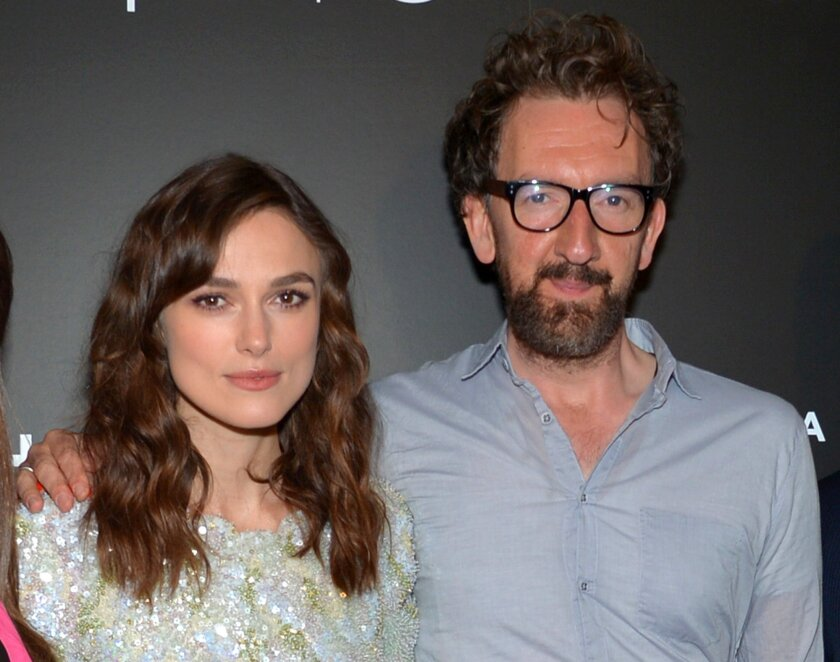 """FILE - This April 26, 2014 file photo shows actresses Hailee Steinfeld, from left, Keira Knightley, director John Carney and actor-musician Adam Levine at the premiere of """"Begin Again"""" at the Tribeca Film Festival in New York. Carney has apologized for slamming Knightley in a recent interview where"""
