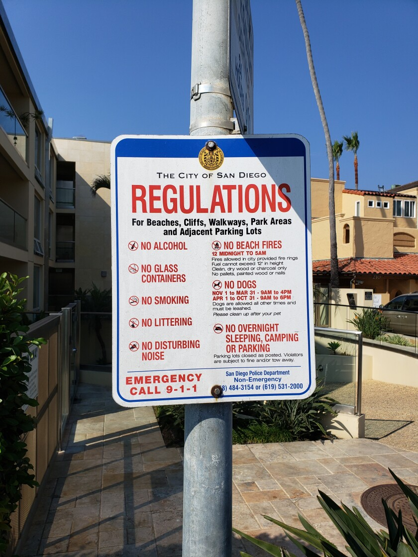 San Diego beach regulations are posted on signs at beach access points.