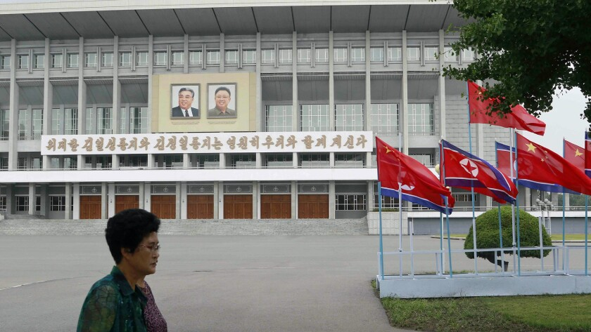 North Korean and Chinese national flags are hoisted on a street in Pyongyang, North Korea Thursday,