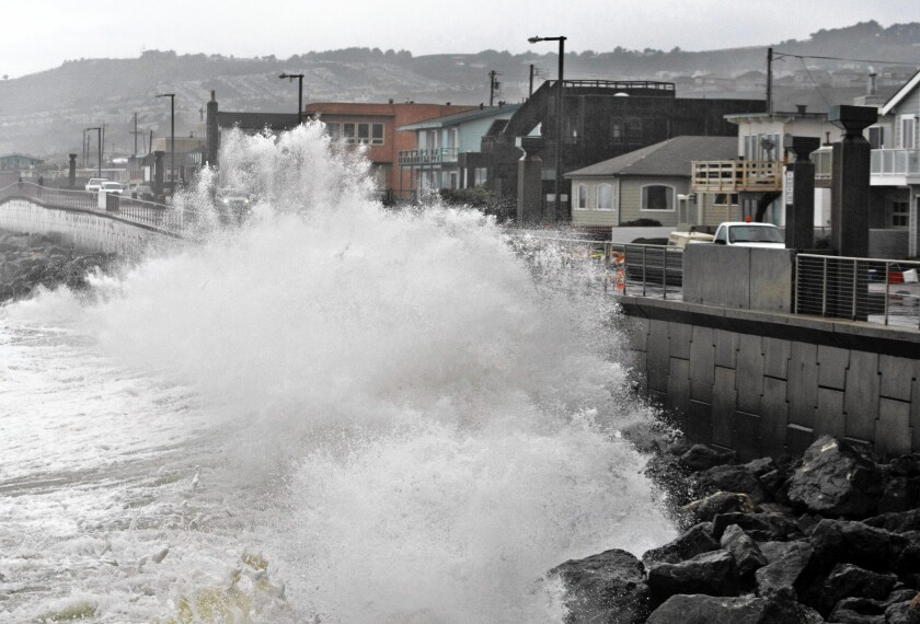 Waves pound a sea wall in Pacifica, Calif., in 2010. Sea levels off the West Coast have been depressed in recent years because of a weather pattern that has lowered ocean temperatures, scientists say. But that is due to reverse.