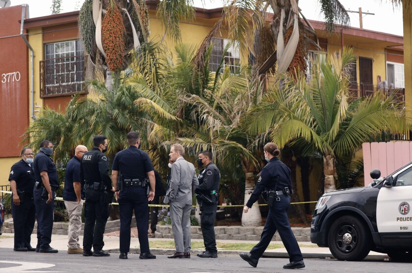 Los Angeles police gather at the scene of a fatal shooting.