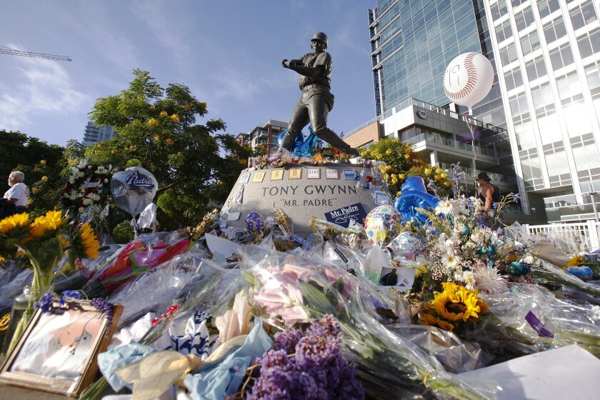 Flowers and mementos surround the Tony Gwynn statue before a memorial service at Petco Park in 2014.
