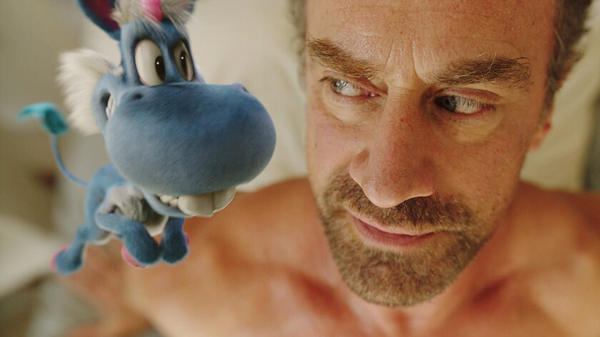 """Happy, voiced by Patton Oswald, and Christopher Meloni in the season premiere of the edgy comedy """"Happy!"""" on Syfy."""