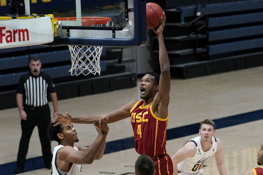 USC's Evan Mobley goes up for a shot over California's Andre Kelly, left, during the first half Jan. 23, 2021.