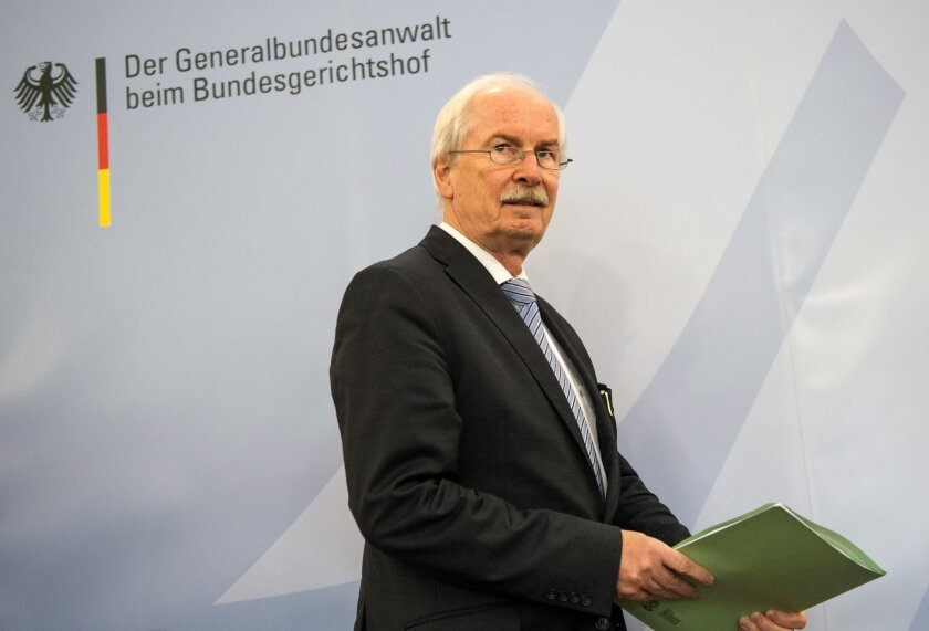 "Chief Federal Prosecutor Harald Range arrives for a news conference in Karlsruhe, Germany, Wednesday, Dec. 11, 2013. Range says he hasn't decided whether to open an investigation of alleged surveillance by the U.S. National Security Agency but is suggesting that he's skeptical. Letters in the background read ""Federal Prosecutor General at the Federal Court"". (AP Photo/dpa, Uwe Anspach)"