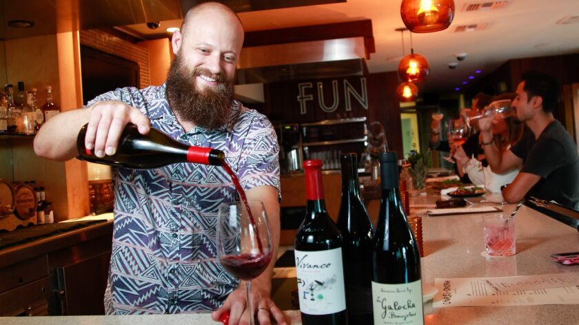 TJ Majeske, bar manager at Charles + Dinorah at The Pearl hotel in Point Loma, pours a Siduri Willamette Valley pinot noir, one of the choices on the modest-sized wine list. The restaurant offers both good variety and value from wineries large and small.