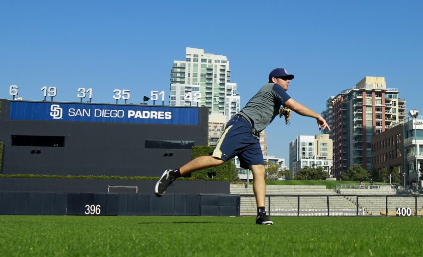 Padres pitcher Tim Stauffer throws during a workout at Petco Park on Thursday, Jan. 19, 2012.