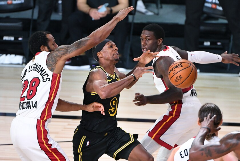 Lakers guard Rajon Rondo has the ball knocked away by Miami's Kendrick Nunn, right, while driving to the basket in Game 2.
