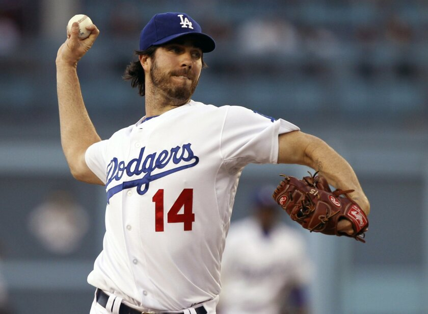 Los Angeles Dodgers starting pitcher Dan Haren throws against the Chicago White Sox in the first inning of a baseball game on Tuesday, June 3, 2014 in Los Angeles. (AP Photo/Alex Gallardo)