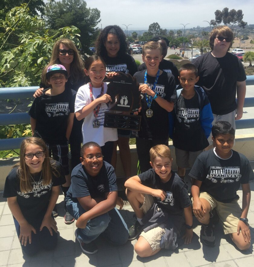 The Ivey Ranch Elementary School chess team won first place in their group in team competition at MiraCosta College recently. Front row: Lily Teta (left), Ja'Mere Hamm, Zach Pieri and Khalif Kamil. Middle row: Troy Griffin, Siran Rao, Camden Burdick, Jaidev Beam and Robert Stockwell. Back row: Teac