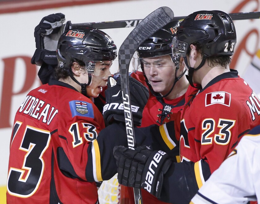 Calgary's line of Johnny Gaudreau, Jiri Hudler and Sean Monahan (from left to right) has stepped up in the wake of Mark Giordano's season-ending injury.