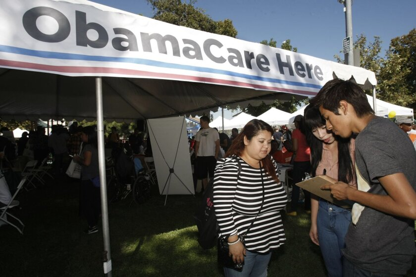 Fremont High School students at the South L.A. Power Festival fill out health surveys and gather information about Obamacare, Sept. 28, 2013, in Los Angeles.