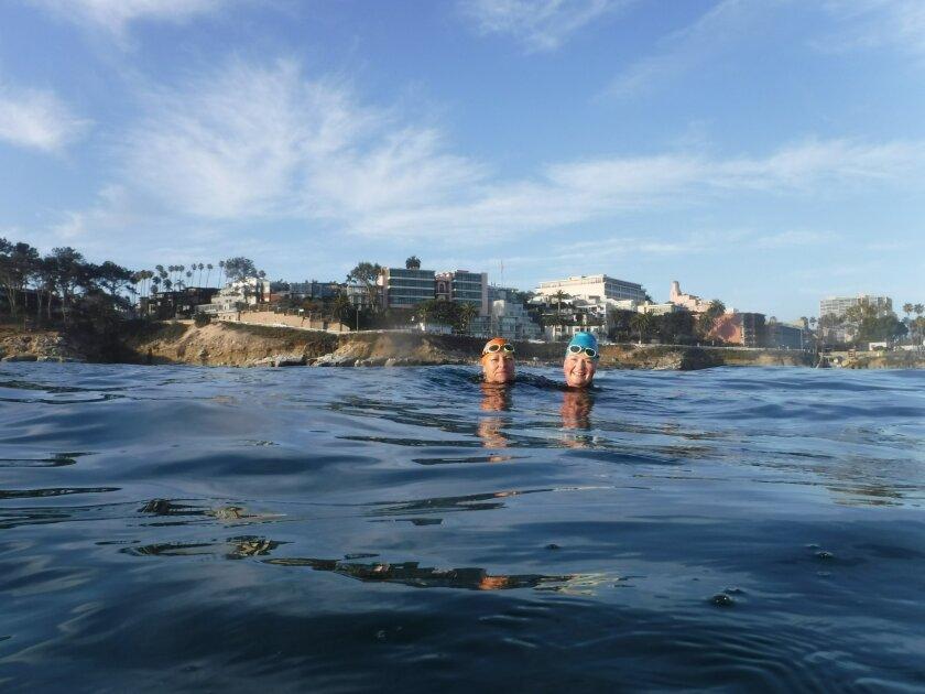 Adriana Issakov (left) and Carmen Gupta go for a swim in La Jolla Cove, recently.