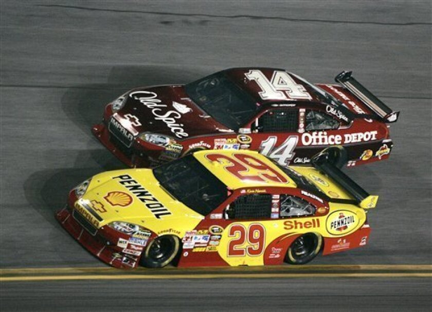 Kevin Harvick (29( and Tony Stewart (14) race for position during the NASCAR Sprint Cup Series Budweiser Shootout auto race at Daytona International Speedway Saturday, Feb. 6, 2010 in Daytona Beach, Fla. Harvick won the race. (AP Photo/Reinhold Matay)