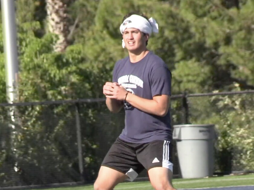 Quarterback Chayden Peery of Sierra Canyon practicing throwing without a ball in June when balls were not permitted.