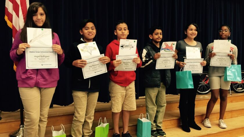 From left to right: Megan Rodriguez, Inigo Borromeo, Blas Sanchez, Carlos Moreno, Selena Gonzalez and Brianna Karo hold up their airplane of the future awards.