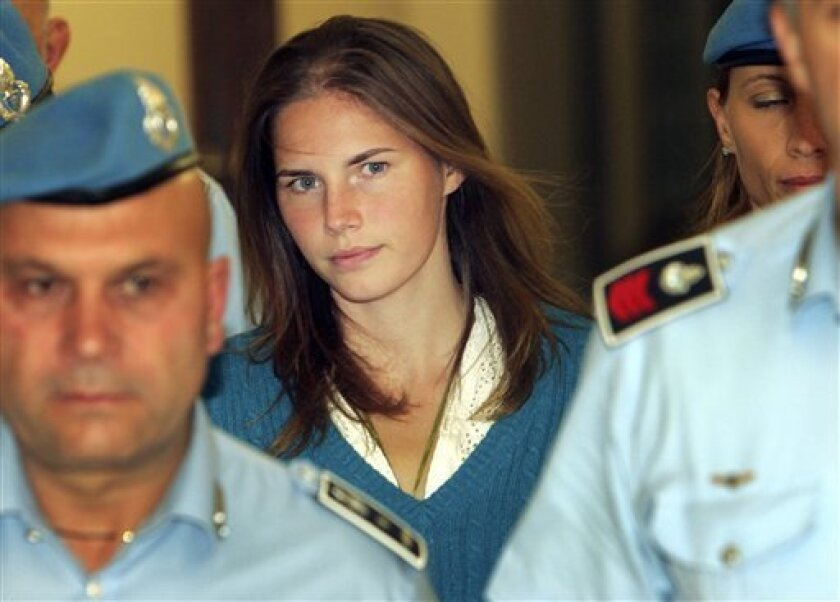 "FILE - In this Sept. 26, 2008 file photo, Amanda Knox is escorted by Italian penitentiary police officers to Perugia's court, Italy, at the end of a hearing. A Florence appeals court Tuesday, July 9, 2013 has set Sept. 30 as the start date for the retrial of American student Amanda Knox in the 2007 death of her British roommate. In March, Italy's highest court overturned Knox's acquittal, faulting the lower court for ""deficiencies, contradictions and illogical"" conclusions in freeing Knox and he"