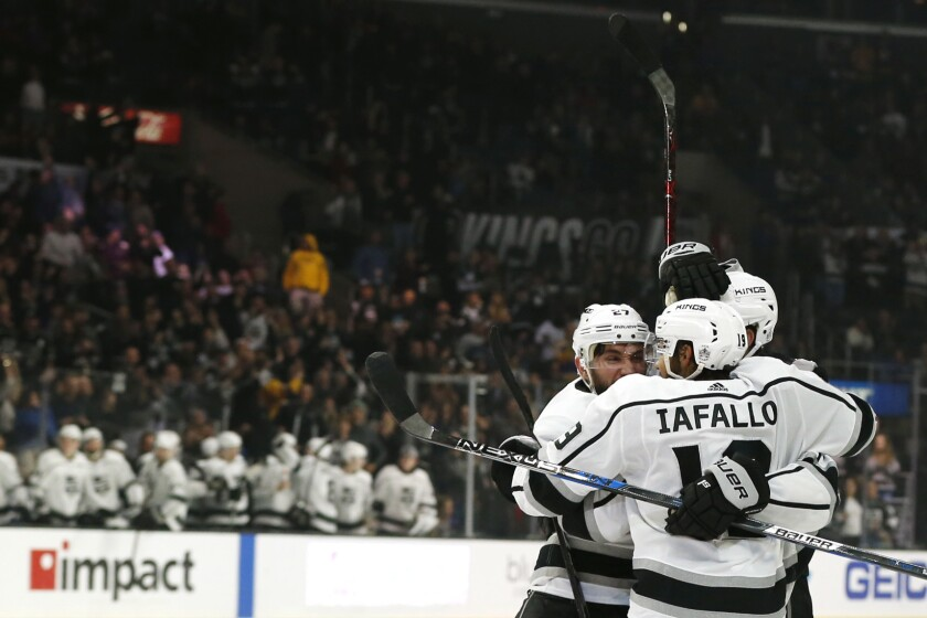 Kings' Alec Martinez (27), Jake Muzzin (6), and Alex Iafallo (19) celebrate Martinez's goal during the third period at Staples Center on Dec. 02, 2018.