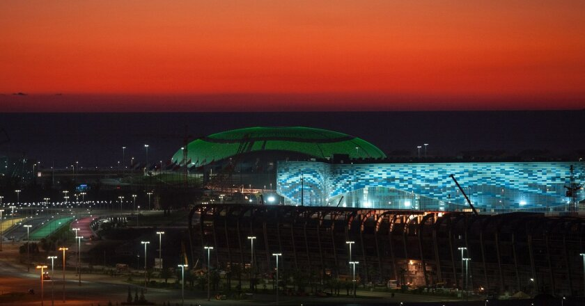 Sochi's Olympic Park includes the illuminated Olympic Bolshoy stadium, in the background, and Iceberg stadium, the location for figure skating and short track speed skating events.