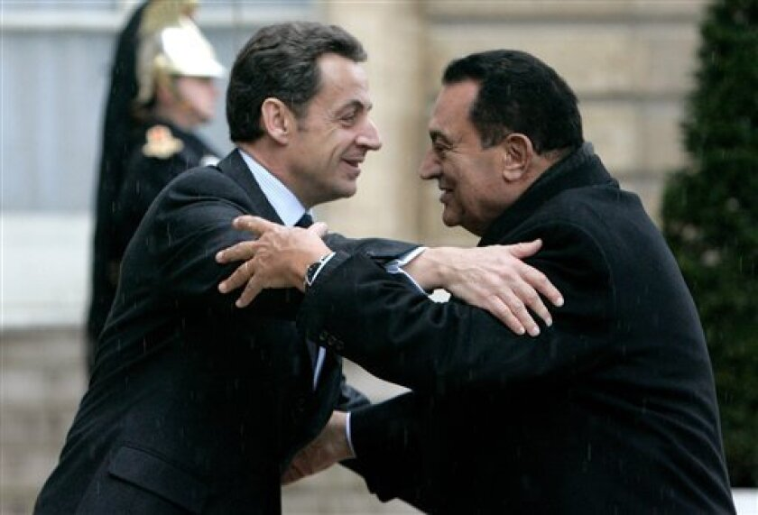 French President Nicolas Sarkozy, left, welcomes Egyptian President Hosni Mubarak at the Elysee Palace in Paris, Monday, Feb. 9, 2009. Mubarak is on a 4-day tour of Europe.(AP Photo/Michel Euler)